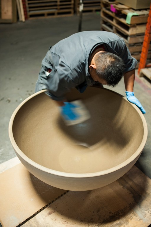 Solus Decor staff person making firepit in Vancouver Canada factory