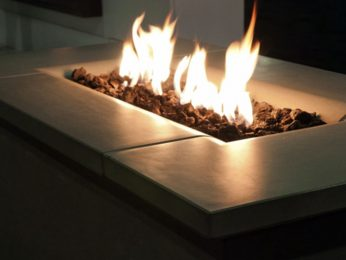 Firetable fire pit lit at night