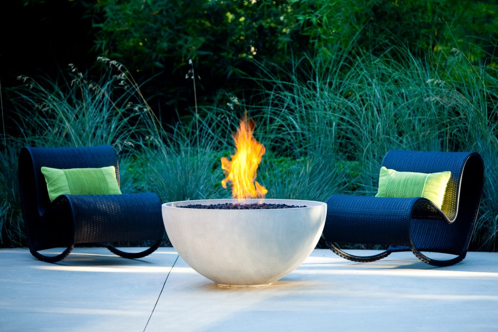 Solus Hemi firepit lit on patio